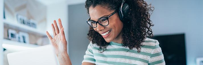 Women on laptop with headphones