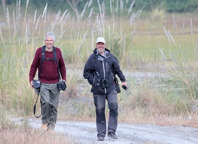 Dr Steb Fisher and Sid Francis returning from a survey
