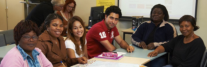 ESL students around desk