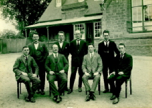 Staff of the Ballarat Junior Technical School prior to vacating the Dana St building.Standing L-R: F.N. King, H.G. Wakeling, S. Mayo, H.V. Maddison. Seated L-R: H.W. Malin, A.W. Steane, W.J. Paterson, R.L. Cutter. (Cat.No.220)
