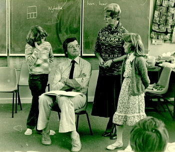 Mary Egan(standing)in a classroom. Barry Fitzgerald, Head of the School of Education at Ballarat College Advanced Education, sits on a chair.(Cat.No.4231)