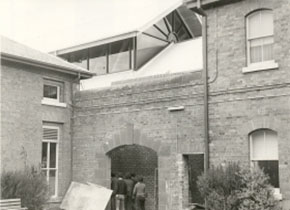 Students enter the SMB Amentities building through a gateway that formed part of the Ballarat Gaol wall